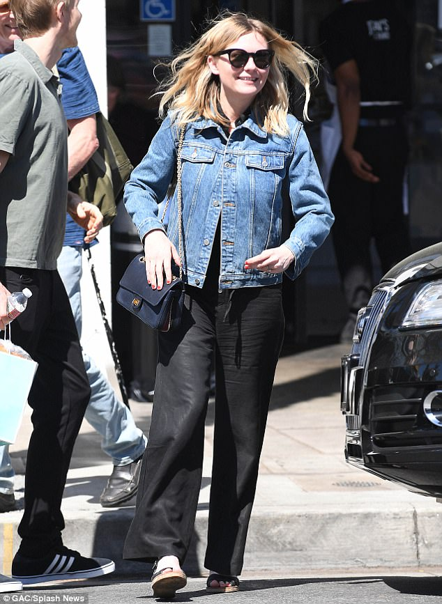 Low key:The 34-year-old paired her engagement ring with a denim jacket and black trousers for her lunch outing