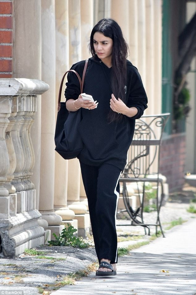 Low key: To run errands, the High Musical star wore a black hooded sweat shirt with matching pants which had a white strip down the side