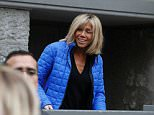 Brigitte Trogneux stands at the entrance as people gather in front of their home in Le Touquet, northeastern France