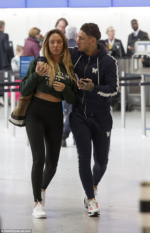 Trouble in paradise?She gushed over her new boyfriend in an interview this week. But Charlotte Crosby didn't look pleased as she headed on holiday with Stephen Bear on Tuesday