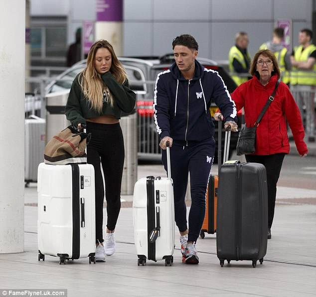 Fuming:Heading into London's Gatwick airport, the former Geordie Shore star, 26, couldn't seem to muster up a smile, even when Bear snuggled up close to her