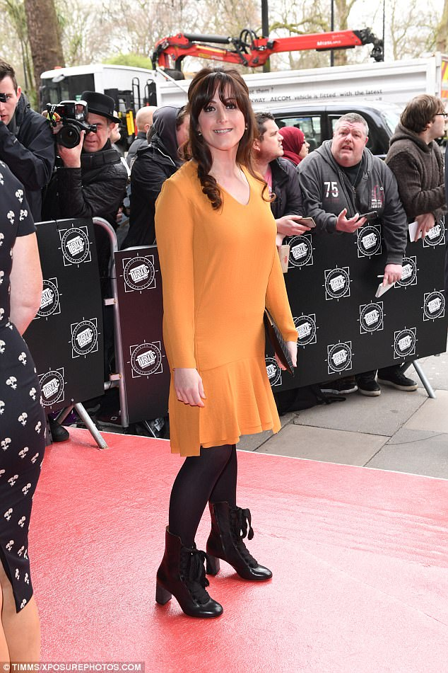 Out in orange: Natalie Cassidy showed off her svelte post-baby figure in a frilled orange dress as she arrived at the TRIC Awards in Grosvenor House, London on Tuesday