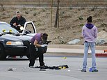Members of the San Diego Police Department collect evidence at the scene of a fatal police officer involved shooting of a 15-year-old boy in one of the parking lots in front of Torrey Pines High School, early Saturday morning. The boy reportedly called the police and when they arrived pointed what appears to be a gun at them. (Howard Lipin/The San Diego Union-Tribune via AP)