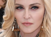 Madonna poses nude and shares topless throwback