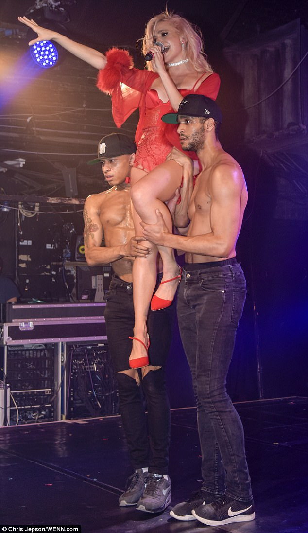 Pin-credible: Pixie showcased her honed pins in the lingerie inspired stage costume