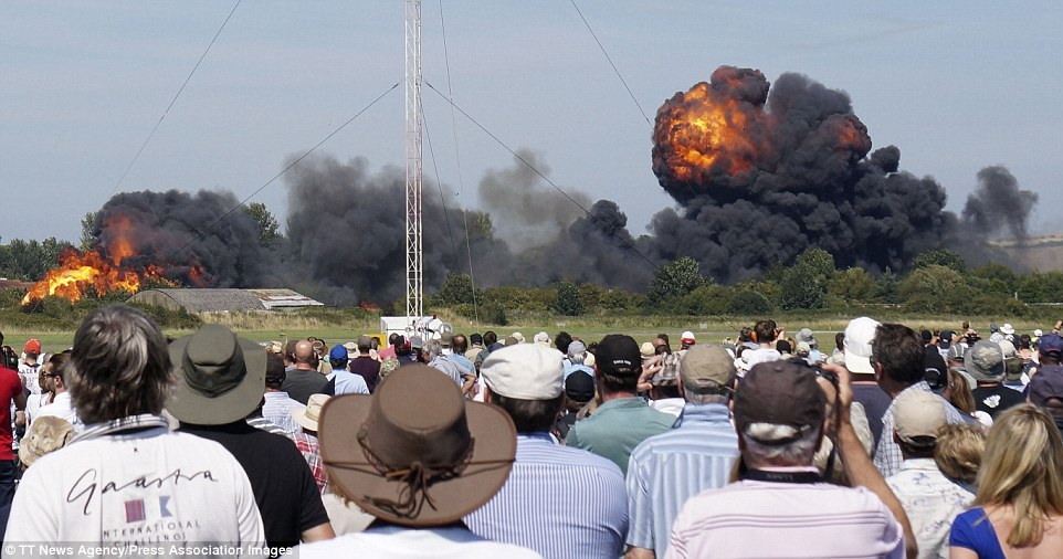 Shock: Hundreds of spectators looked on in horror after the Hawker Hunter crashed into the ground and instantly burst into a fireball