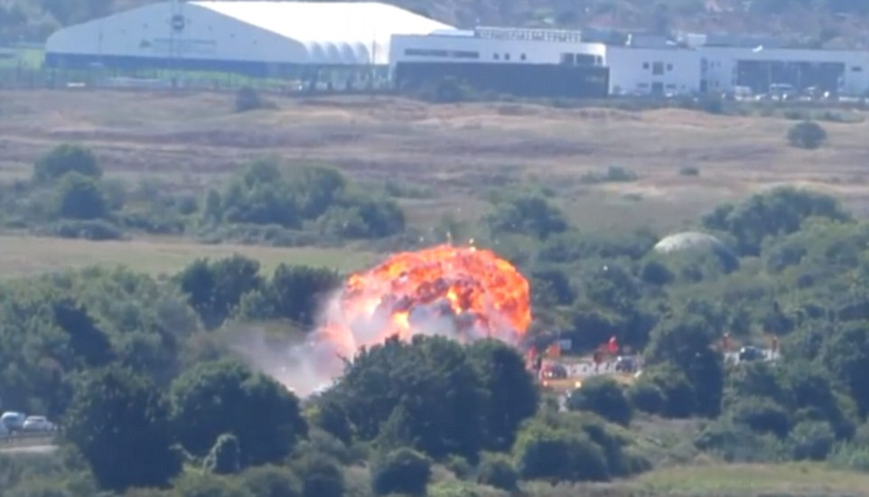 Fire: The jet smashed into traffic on a busy road and burst into flames after failing to pull up from a loop-the-loop stunt during the airshow