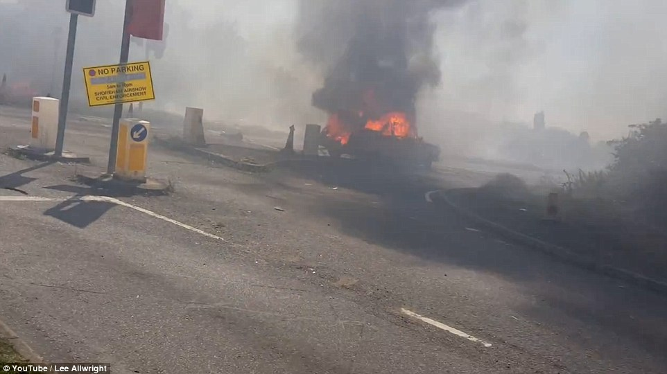 Smoke: The disintegrating jet sprayed aviation fuel all over the carriageway engulfing a Daimler DS420 which was on its way to a wedding