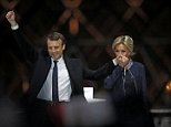 Emmanuel Macron and his wife Brigitte (pictured) addressed his adoring supporters outside the Louvre in central Paris just hours after he was elected the youngest French president