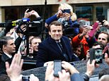 Independent centrist Macron and his wife Brigitte were mobbed by fans as they went to vote at the polling station in Le Touquet this morning