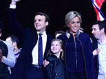 Emmanuel Macron and his wife Brigitte (pictured) addressed his adoring supporters outside the Louvre in central Paris last night just hours after he was elected the youngest French president