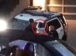 Conrad Hilton, the brother of Paris Hilton, is seen in the video footage above as he is being arrested by police in Los Angeles at around dawn on Saturday. Hilton is wearing a light-colored hooded sweater as he stands before a police officer