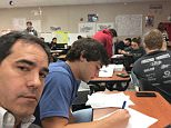 A Texas father sat in on his 17-year-old son's physics class on Friday after receiving a series of messages from his son's teacher about his bad behavior. They are pictured together in physics class on Friday