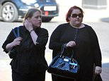 Deborah Harrison (left) and her partner Jennifer (right) are accused of attacking Deborah's teenage daughter with a hammer as 'punishment' for her stealing sweets