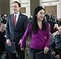 FILE - In this Jan. 28, 2014, file photo, Clay Pell, left, grandson of the late Sen. Claiborne Pell, D-RI, and his wife, two-time Olympic figure skating medalist Michelle Kwan, right, enter the Rhode Island Convention Center in Providence, R.I., to begin his campaign for governor of Rhode Island. Kwan filed papers in Rhode Island seeking divorce days after her husband, Clay Pell, filed for divorce in California. Pell filed for divorce March 27, 2017, while Kwan filed March 30, 2017. (AP Photo/Stephan Savoia, File)