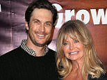 """HOLLYWOOD, CA - MAY 04:  Actor Oliver Hudson (L) and mother actress Goldie Hawn attend the premiere of Roadside Attractions' & Godspeed Pictures' """"Where Hope Grows"""" at ArcLight Cinemas on May 4, 2015 in Hollywood, California.  (Photo by David Livingston/Getty Images)"""
