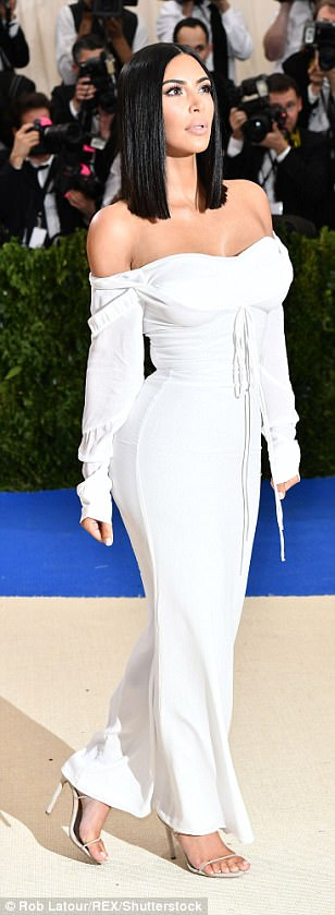 Understated: Kim, 36, who is famous for baring her skin, stunned in the very simple dress