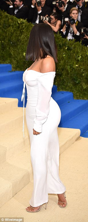 Played down her curves: Kim's famous derriere was covered by the simple dress that had a plain zipper down the back