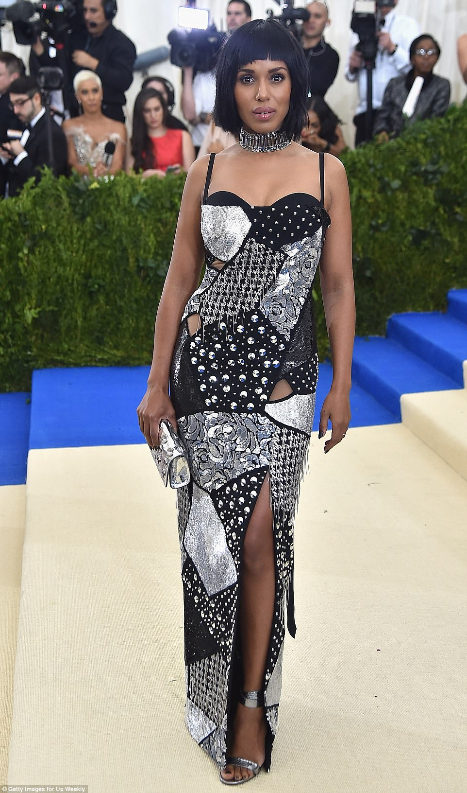 Stunner: Kerry Washington rocked a bold black and silver dress with a severe bob at Monday night's Met Gala in NYC