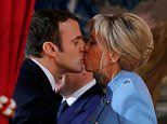 Emmanuel Macron was seen kissing his glamorous wife after being inaugurated as France 's youngest ever president