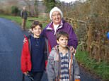 Valerie Johnson (pictured with her grandsons) mistakenly drove for eight hours rather than ten minutes  when roadworks diverted her