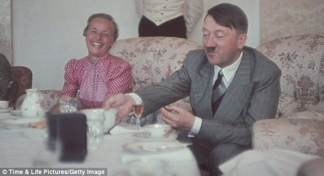 The German leader eats a meal with the wife of Gauleiter Albert Forster, at the Berghof, Hitler's estate in Upper Bavaria in the late 1930s