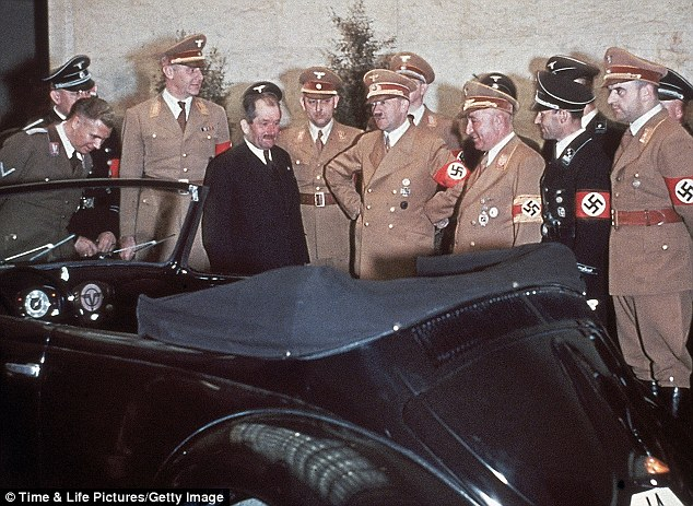 Hitler (hands on hips) admires his new car, which was presented by the manufacturer Ferdinand Porsche. The Fuhrer did not like to drive himself and had a chauffeur