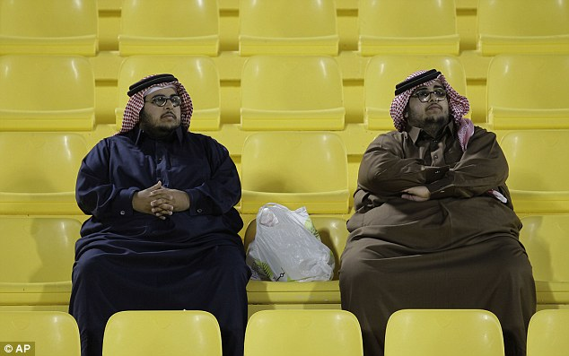 Seat wave: Two fans wait for South Korea and Bahrain to kick off