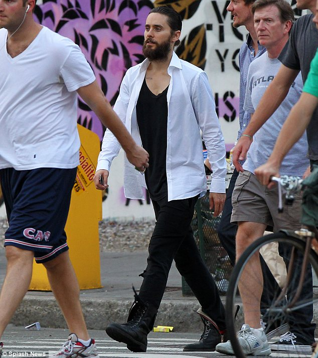 The morning after: Jared was without Scarlett today when he was seen enjoying some time with friends in New York's East Village