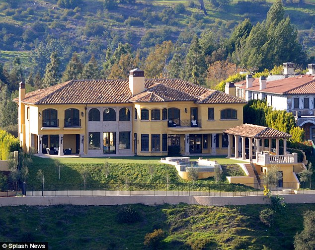 Ongoing: Major renovations are being carried out on Kim and Kanye's $10,750,000 Spanish style mansion, just three doors away from Ramsay's pile