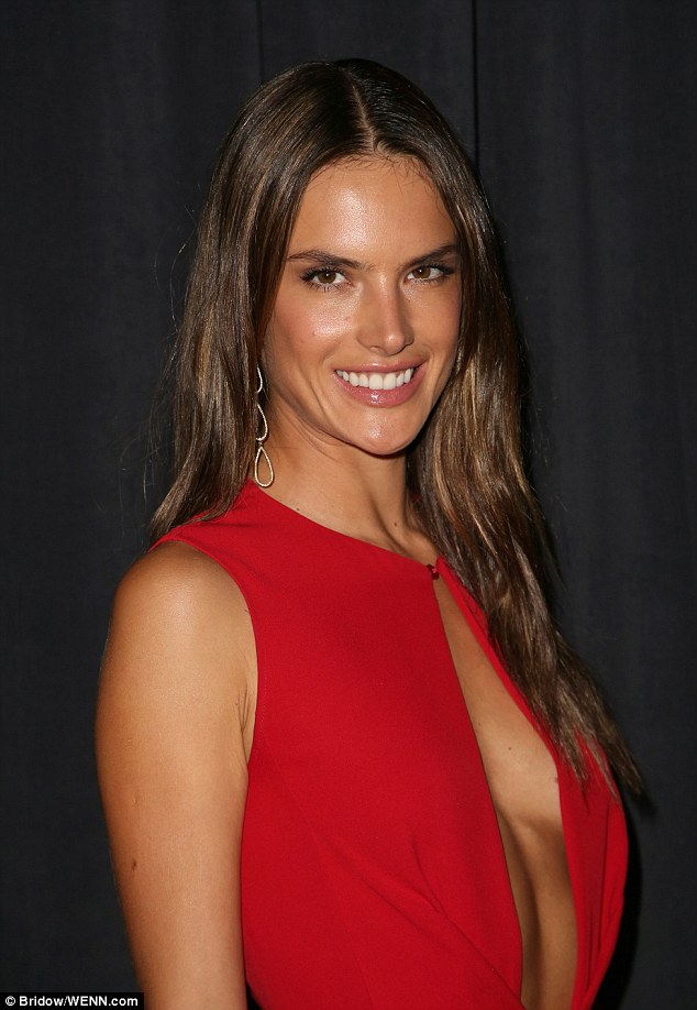 Fixed grin: Alessandra Ambrosio pasted on her most winning smile at the Wallis Annenberg Center For The Performing Arts Inaugural Gala Presented By Salvatore Ferragamo - but she left home with her engagement ring