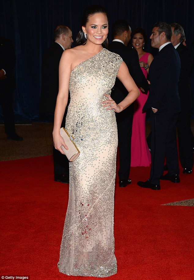 Like a diamond: Model Chrissy Teigen was a vision in a sparkling cream one shoulder gown