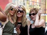 Making memories: Marla Maples posed for photos at the site of a fatal Times Square car crash on Thursday, smiling for pics just feet from where a teenage girl lost her life