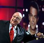 FILE - In this July 24, 2006 file photo, Roger Ailes, chairman and chief executive officer of Fox News, listens as anchor Shepard Smith, seen on screens in front and behind him, as Smith talks to the audience via satellite from Israel, at the Summer Television Critics Association Press Tour in Pasadena, Calif.  Fox News said on Thursday, May 18, 2017, that Ailes has died. He was 77. (AP Photo/Reed Saxon)