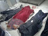 ISIS savages have executed and then dismembered dozens of women and children amid fears the terror group is plotting a wave of massacres in Shiite villages. Body bags were laid out on the floor after an ISIS raid inAqareb (pictured)