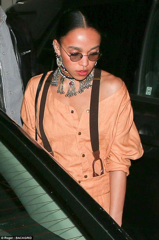 Simple chic:His fiancée Twigs - real name Tahliah Debrett Barnett - styled her raven tresses in plaits and added a pair of chic sunglasses to her attire
