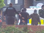 Armed officers this afternoon also executed warrants at a block of flats in Whalley Range and at a redbrick home in Fallowfield
