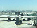 This is the plane that passengers have been disembarked from Dubai to Heathrow following a bomb threat