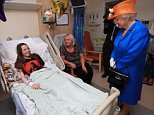 The Queen speaks to Millie Robson, 15, and her mother Marie, from Co Durham, during a visit to the Royal Manchester Children's Hospital. Millie, who was wearing an Ariana Grande concert t-shirt, beamed as she spoke to the monarch, 91, from her hospital bed. The schoolgirl was among the 12 children taken to the hospital in the aftermath of the attack on Monday