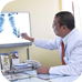 TB doctor pointing at lung xray