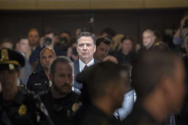 "Former FBI director James Comey walks through a corridor on the way to a secure room to continue his testimony to the Senate Select Committee on Intelligence, on Capitol Hill in Washington, Thursday, June 8, 2017. Comey, who was fired by President Donald Trump, told the panel in open session that Trump repeatedly pressed him for his ""loyalty"" and directly pushed him to ""lift the cloud"" of investigation by declaring publicly the president was not the target of the probe into his campaign's Russia ties."