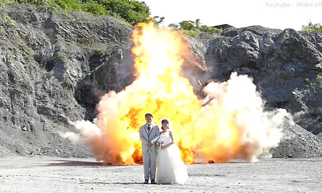 Japanese couple take wedding photos in front of EXPLOSION