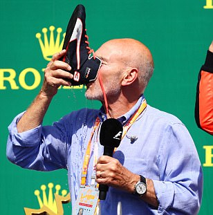 Patrick Stewart drinks champagne out of Ricciardo's boot