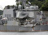 The navy is investigating the possibility that some of the men who died aboard the USS Fitzgerald when it was hit by the ACX Crystal (pictured) early Saturday morning were trapped in their rapidly flooding sleeping quarters by emergency hatches