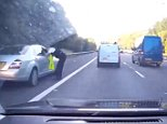 In the footage, captured on the M40 near High Wycombe, Buckinghamshire, yesterday, the Mercedes (left) skips past stationary traffic only to get its immediate comeuppance