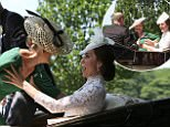 HRH Sophie, The Countess of Wessex loses her balance and falls on to HRH Catherine, The Duchess of Cambridge as the carriages pull away ahead of Day 1 of  Royal Ascot 2017