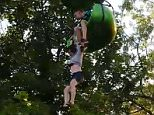 The 14-year-old was filmed dangling in the air after becoming stuck