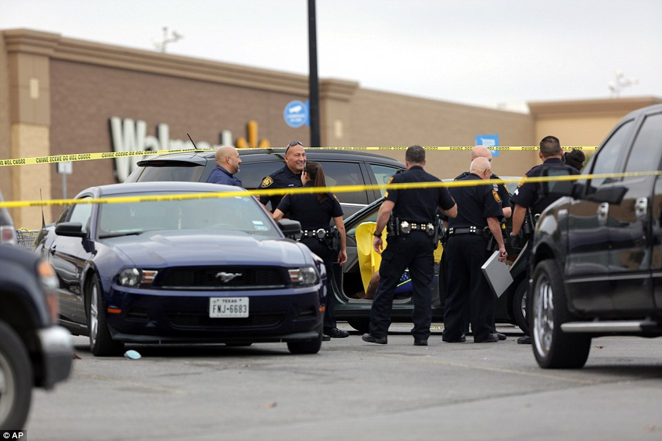 San Antonio police investigate the scene of a shooting in the WalMart parking lot about 4pm on Black Friday in Texas