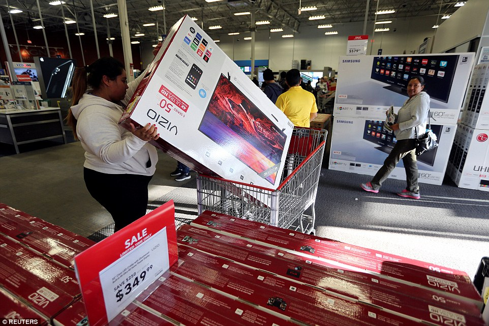 A woman puts a television product in her cart during Black Friday sales at a Best Buy store in Los Angeles, California on Black Friday