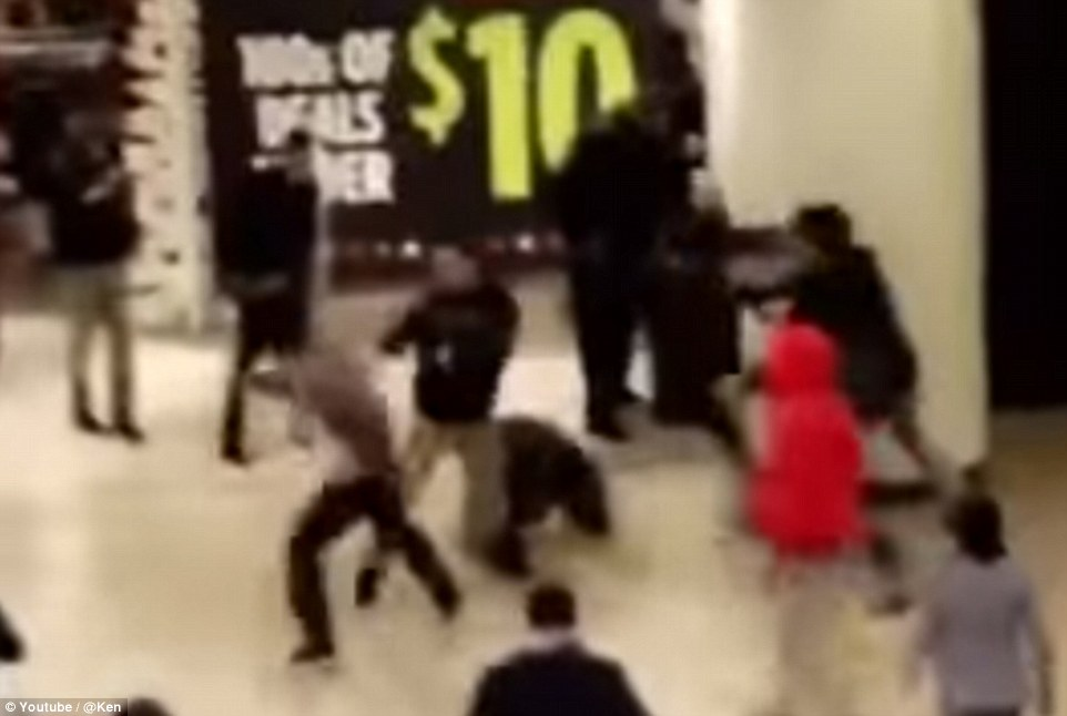 Many on lookers were seen watching as several other fights broke out in front a sign that was advertising 'hundreds of deals for under $10'
